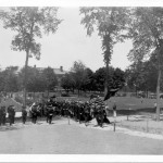 Serenaded by the band, grads head to gym for Commencement dinner,1930.