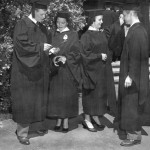 "1953 graduates John Sturgis, Barbara Earl, Beverly Bragdon, and Neil ""Pete"" Borden gather in front of the chapel."