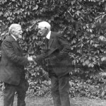 Dr. Arthur Given and Dr. Frank Sleeper, members of the first Bates College graduating class (1867), greet each other at their 55th reunion, 1922.