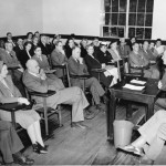 Alumni listen attentively as Prof. Anders Myhrman leads a seminar during the first Alumni College, 1948.