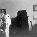 All the comforts of home — caretaker Josiah Brown oversees Chase Hall guest rooms for visitors and alumni, c. 1928.
