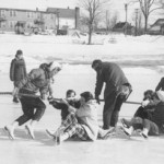"During the '59 carnival, participants of all ages fight for traction in a tug-of-war on ""The Puddle."""