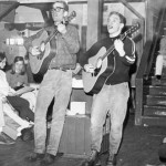 In the 60's students enjoy some musical entertainment while taking a break from outdoor activities.