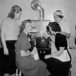 The 1939 Carnival Queen and her attendants mix up a delicious lobster stew.