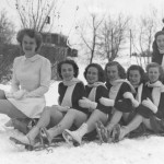 Members of the 1948 Carnival court, including Queen Jeanne Mather, pose atop a toboggan.