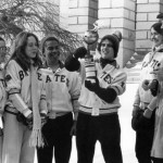 Students look on after Maine's Governor Longley lights the torch opening the 1978 Winter Carnival games.