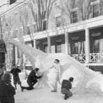 Parker Hall East residents put the finishing touches on the dinosaur that won them the 1939 snow sculpture competition.