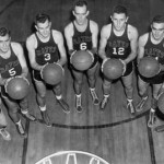 Members of the 1949-1950 men's basketball team set their sights on the hoop.