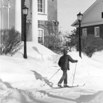 A lone cross-country skier glides past Hathorn Hall.