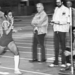Norm Ross clocks Donna Broadway as she carries the baton and the Bates 800-meter relay squad to victory over Harvard, 1981.