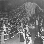 Formally attired couples sway across the Alumni Gym floor at the annual Pops Concert, 1952.