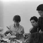 During a Short Term program in China, an instructor appears amused at Bates students' feeble attempts to handle chopsticks, 1981.