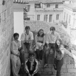 A shot of a Short Term group affords a look over the rooftops of a Grecian town, 1981.