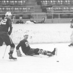 A Bates icer loses his footing in a 1970 game.