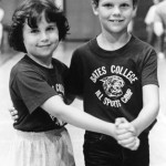 This cute couple obliges the photographer as they await the start of the Contradance, 1985.