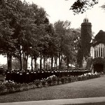Then: (May) The end of the beginning: Luxuriant spring foliage makes the backdrop for a Commencement procession to the Chapel.  Photographer unknown, 1930s photo, gelatin silver print, the Edmund S. Muskie Archives and Special Collections Library.