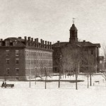 Then: (January) In this image taken more than a century ago, Bates' two oldest buildings face the still-young trees on the historic Quad. Parker (at left) and Hathorn halls were opened in 1857.  Photograph by Miles Greenwood, 1894, gelatin silver print, the Edmund S. Muskie Archives and Special Collections Library.