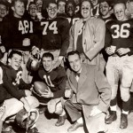 Then: (November) With Coach Bob Hatch at center, the 1956 Bobcats celebrate their 38-13 win over Colby, a victory that netted Bates football the State Series Championship and Governor Barrows Trophy.   Photographer unknown, 1956, gelatin silver print, the Edmund S. Muskie Archives and Special Collections Library.