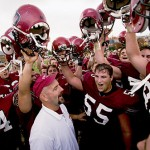 Now: (November) Bates football coach Mark Harriman joins the traditional singing of the Bates fight song after a 20-17 Garcelon Field victory over Bowdoin College in 2003.   Photograph by Phyllis Graber Jensen.
