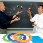 "Now: (December) Professor of Mathematics David Haines, at left, juggles with Dominic Lee '04 during a Short Term class. ""In learning math, as in juggling, it is important to accept our mistakes and start over again until we get it right,"" says Haines."