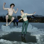 Now: (February) Adam Dengler '07 and Teah Muller '07 take the plunge in 2004 during the annual Puddle Jump.  Photograph by Phyllis Graber Jensen.