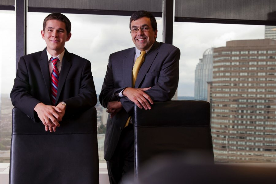 Ladd intern Zach Polich '15 and TM Capital managing director Brad Adams '92
