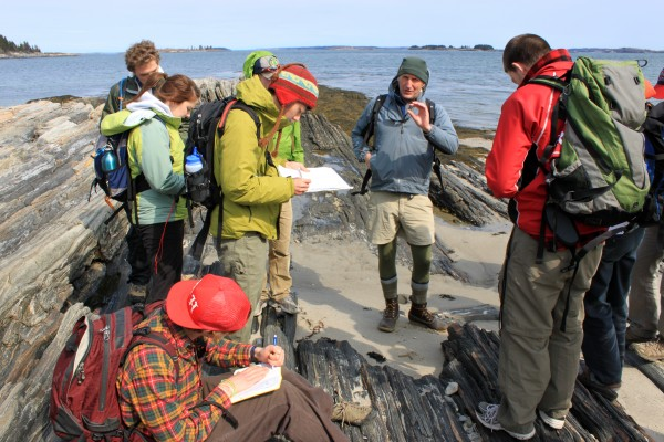 Camille Parrish and Dykstra Eusden lead a field trip to Maine's Cliff Island to teach students how to identify and measure the different rock formations to create a surficial geology map in ArcGIS.