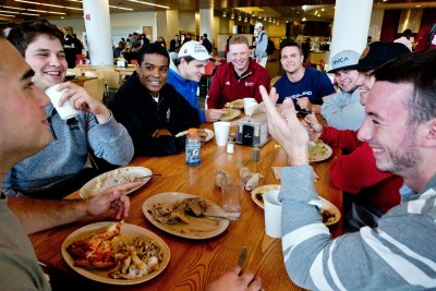 Back To Bates Weekend. Families and Alumni return to campus for a weekend of scheduled and spontaneous fun and stimulation. Football friends at lunch in Commons.