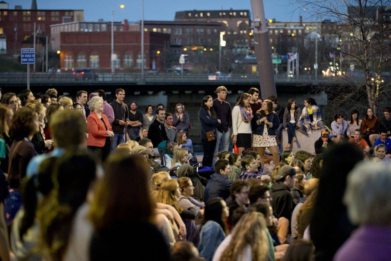 A crowd enjoys Bates student performances in Auburn's Festival Plaza.