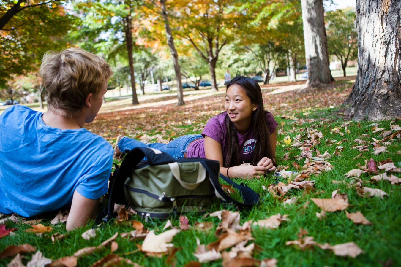 Alexa Adams '17 enjoys warm fall weather and conversation with Hunter Moeller of Cleveland, OH (Bowdoin Student) Tuesday on the Historic Quad.