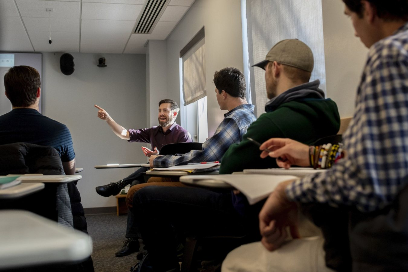 """Dr. Kelton McMahon '05 of the University of Rhode Island was on campus today, Jan. 14, to give a talk, """"Transforming the Study of Ocean Food Webs:  Atoms to Ecosystems,"""" sponsored by the biology department (Monday, January 14th – 4:10 – 5:30 pm Carnegie Science, Room 204).  In these photographs, oceanic ecogeochemist Kelton McMahon '05 speaks to a Junior Seminar taught by Larissa Williams, associate professor of biology. It's considered a Purposeful Work infusion course. Time: 1-4pm in Carnegie 111.   Please note: Textbooks may be ordered a few weeks in advance of, and through the end of each semester BIO 460 - Junior Seminar Reading original biological literature is an essential skill for biology majors. Focusing on the topics addressed by invited speakers for the semester's biology seminar program, students review articles, write analyses, and contribute oral presentations in a small group format. Students attend afternoon and/or evening seminars and discuss the content, context, and presentation of original investigations."""