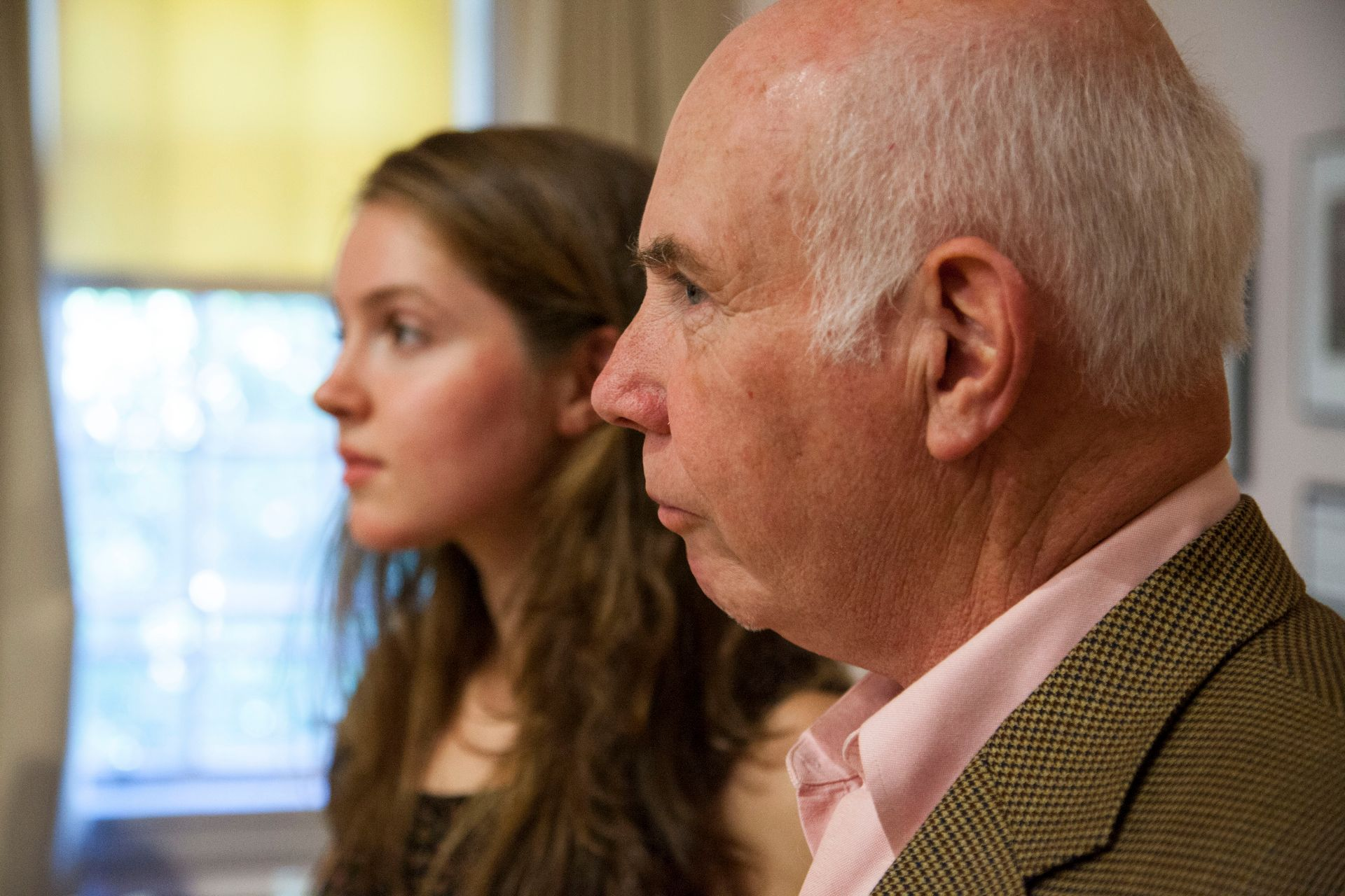 Richard Bevins and daughter Katherine Whitaker at the College Key annual meeting at Reunion 2014, June 6, 2014, in Muskie Archives, which included a posthumous award to his wife and her mother, longtime Bates administrator Elizabeth Sheppard. who died in June 2013. (Jay Burns/Bates College)