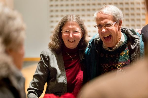 Susan Dumais '75 laughs with Professor Emeritus of Psychology John Kelsey before her talk on Feb. 1. Dumais first met Kelsey in the 1970s when she was a doctoral student at the University of Indiana, where he was starting his faculty career. (Phyllis Graber Jensen/Bates College)