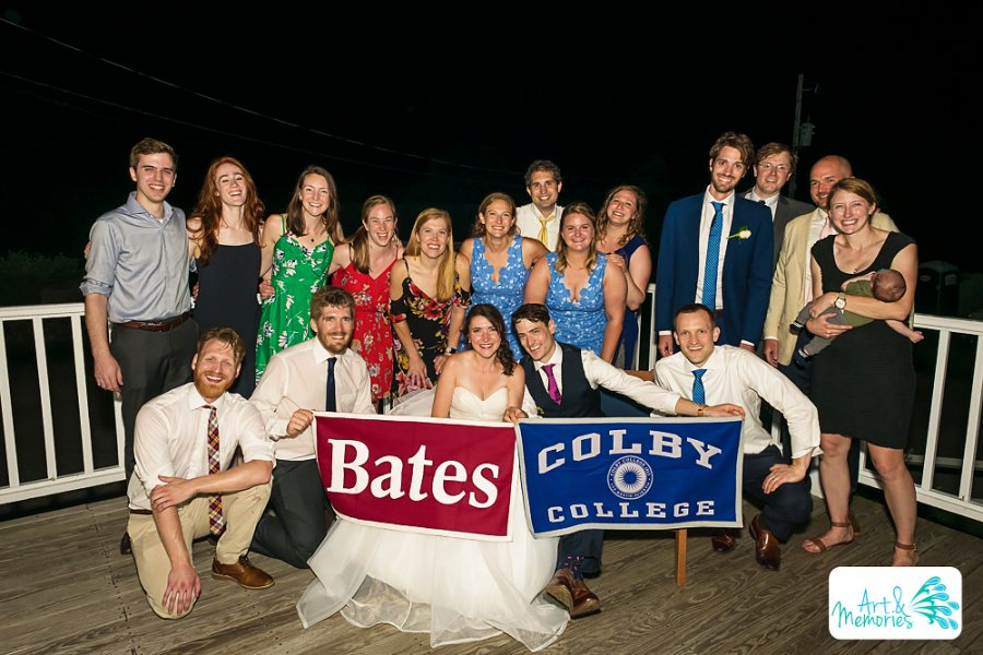 """""""This photo was taken at my wedding this summer. My husband is a Colby grad, so we decided to take a joint photo and I thought this one came out well and shows how well we can all get along with our rivals :)"""" — Katie Black '12  Back row, left to right: Connor Pacala '12, Alexa Hiley '12, Katie Thorn '12, Becca Gugliotti '12, Tessa Pals '12, Caylin Carbonell '12, Jeff Higgins '12, Leah Maciejewski '12, Nina Wolinsky '12 Front row, left to right: John Weidman '12, Michael Dorfman '12, Katie Black '12"""