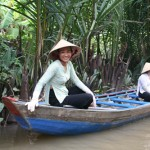 Young Ladies on the small boat, on a cannel, Mekong Delta.