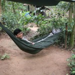 Visting Cu Chi Tunnels, Prof. Trian Nguyen resting in hammock.