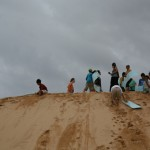 Visiting the Sand Dunes, Mu Ne. Prof. Trian climbed the sand dune after sledding down to the bottom.