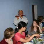 Abbot of the Linh Mu Temple playing flute for students.