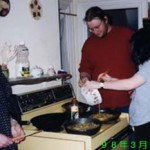 "From the left, Elizabeth Purinton '98, Greg, Megan Tobin '00, cooking ""tamago donburi"" (egg & rice dish),"" March 15, 1998, JPN 202~402 Party"