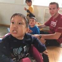 Christopher Lee ('18) Entertains Children at the New Hope Foster Home near Beijing, Short-Term in China, 2017