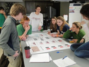 Andy Wood '11, (ctr) TA for Bio 270 (Ecology and Evolution), facilitates as students discuss the results of their white pine demographics study at Range Ponds State Park.