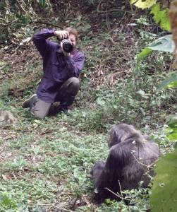 Andrew Bernard photographs a chimpanzee in Kibale National Park, Uganda.
