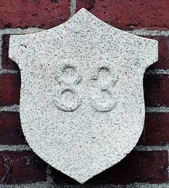 The 1883 ivy stone is on Hathorn Hall facing Dana Chemistry Hall.