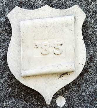 The 1885 ivy stone is on Hathorn Hall facing Dana Chemistry Hall.