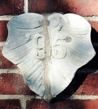 The 1895 ivy stone is on the side of Hedge Hall facing Ladd Library.