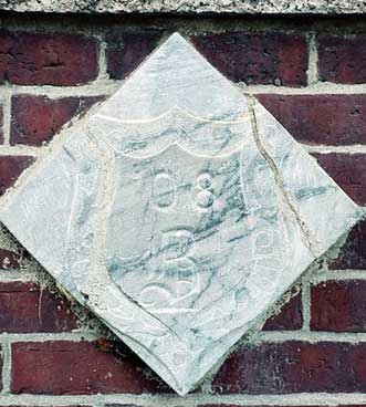 The 1908 ivy stone is on Hedge Hall facing Roger Williams Hall.