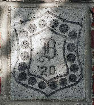 The 1920 ivy stone is on Chase Hall facing Campus Avenue.