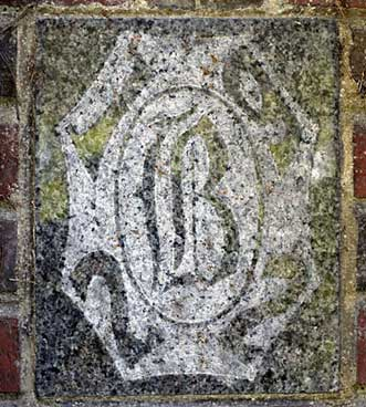 The 1922 ivy stone is on Chase Hall facing Campus Avenue.