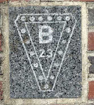 The 1923 ivy stone is on Chase Hall facing Campus Avenue.