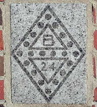 The 1924 ivy stone is on Chase Hall facing Carnegie Science Hall.